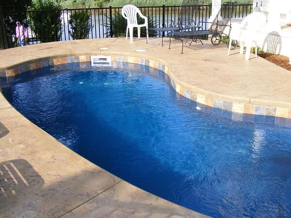fiberglass pool with cantilevered concrete coping