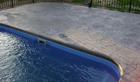 A picture of stamped (jumbo stone) concrete pool patio