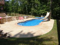 fiberglass pool installed by river pools and spas in fredericksburg with slide