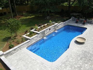 fiberglass pool with retaining wall