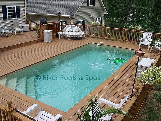 elevated fiberglass pool wwood decking above ground composite pool deck