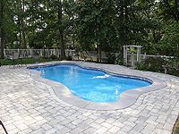 Light Grey Broomed Concrete Patio With Pavers