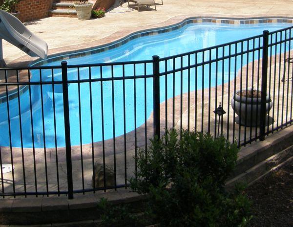 fiberglass pool with black powder coat aluminum fence