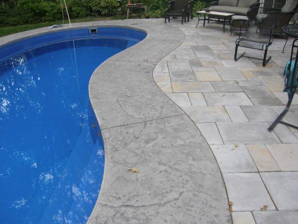 Cantilevered concrete coping around a fiberglass pool
