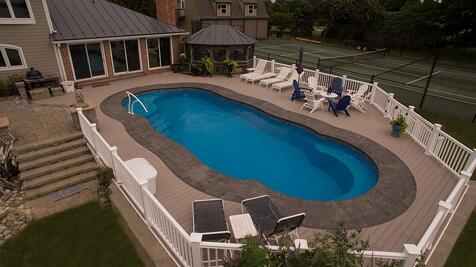 Above ground fiberglass pool with deck