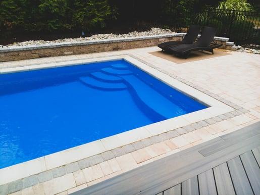 Rectangular fiberglass pool with bench seating