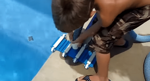 kid-vacuuming-inground-pool