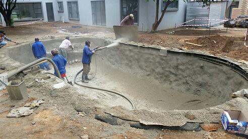 spraying on a concrete pool