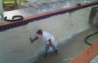 Builder troweling the plaster to a smooth finish