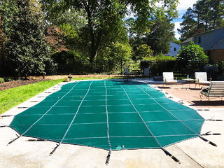 Pool cover over inground pool - is it time to winterize your swimming pool?