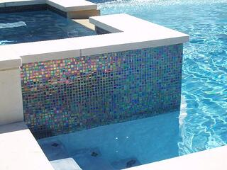 Glass tile on a concrete pool - what is the best interior finish?