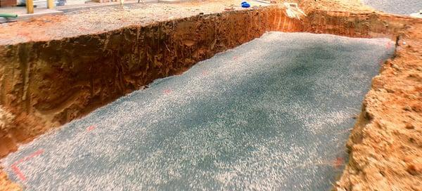 Gravel floor under the pool shell