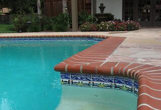 Porcelain waterline tile on a concrete pool