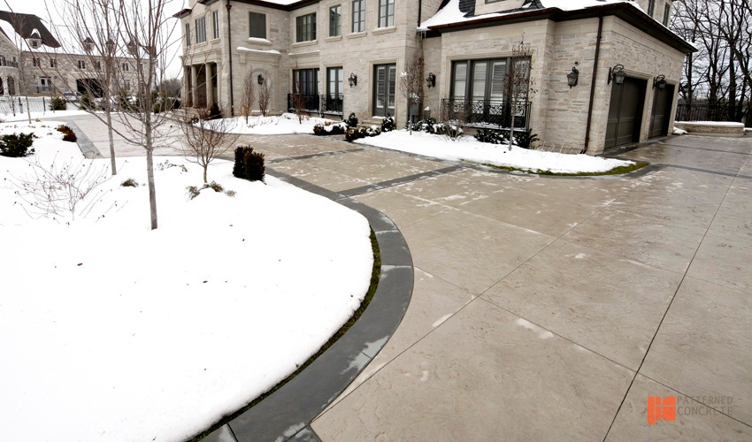 snowy house and stamped concrete