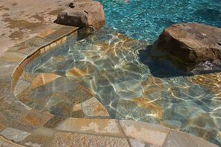 Stone tile on a concrete pool