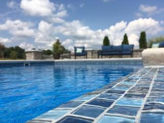Blue glass tile on a pool tanning ledge