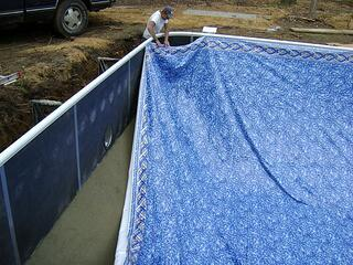 Installing vinyl liner on the pool