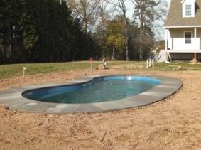 fiberglass pool with concrete apron