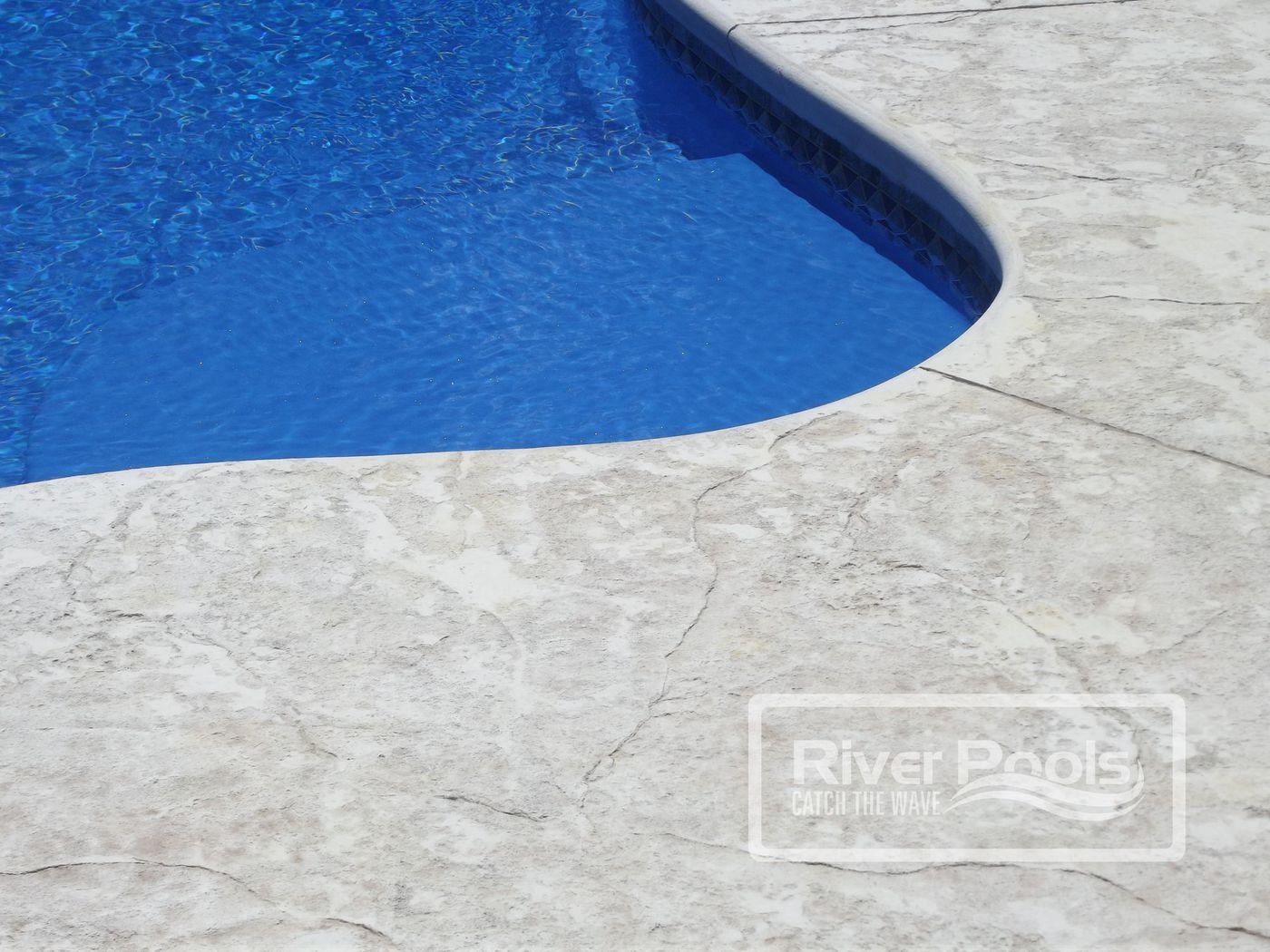 Textured concrete pool patio