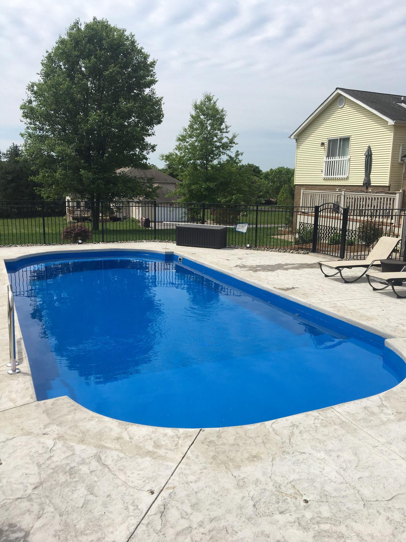 Roman Lounger inground fiberglass pool with tanning ledge