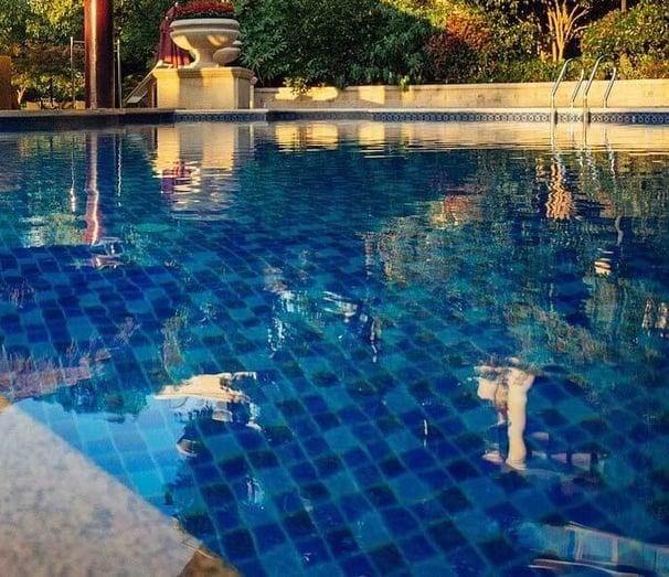 dark blue tiled swimming pool