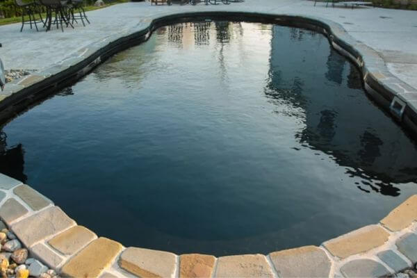 Dark bottom inground pool