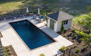 black rectangular fiberglass pool with pool house