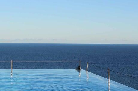 infinity pool by the ocean