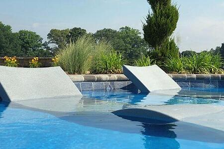 in-pool furniture on tanning ledge