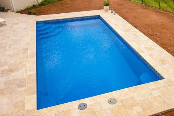 small inground pool with coping and patio