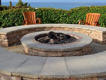 stone fire pit with bench seating