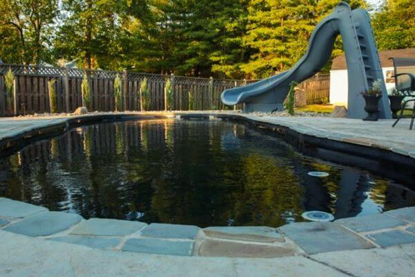 black bottom fiberglass pool with slide
