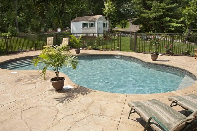 freeform vinyl liner inground pool with patio