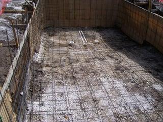 Steel rebar for a concrete pool