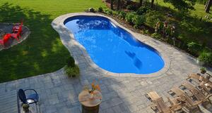 lighter blue C Series pool with tan stone patio