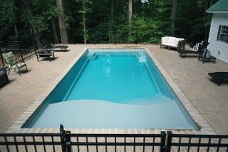 Grey fiberglass swimming pool