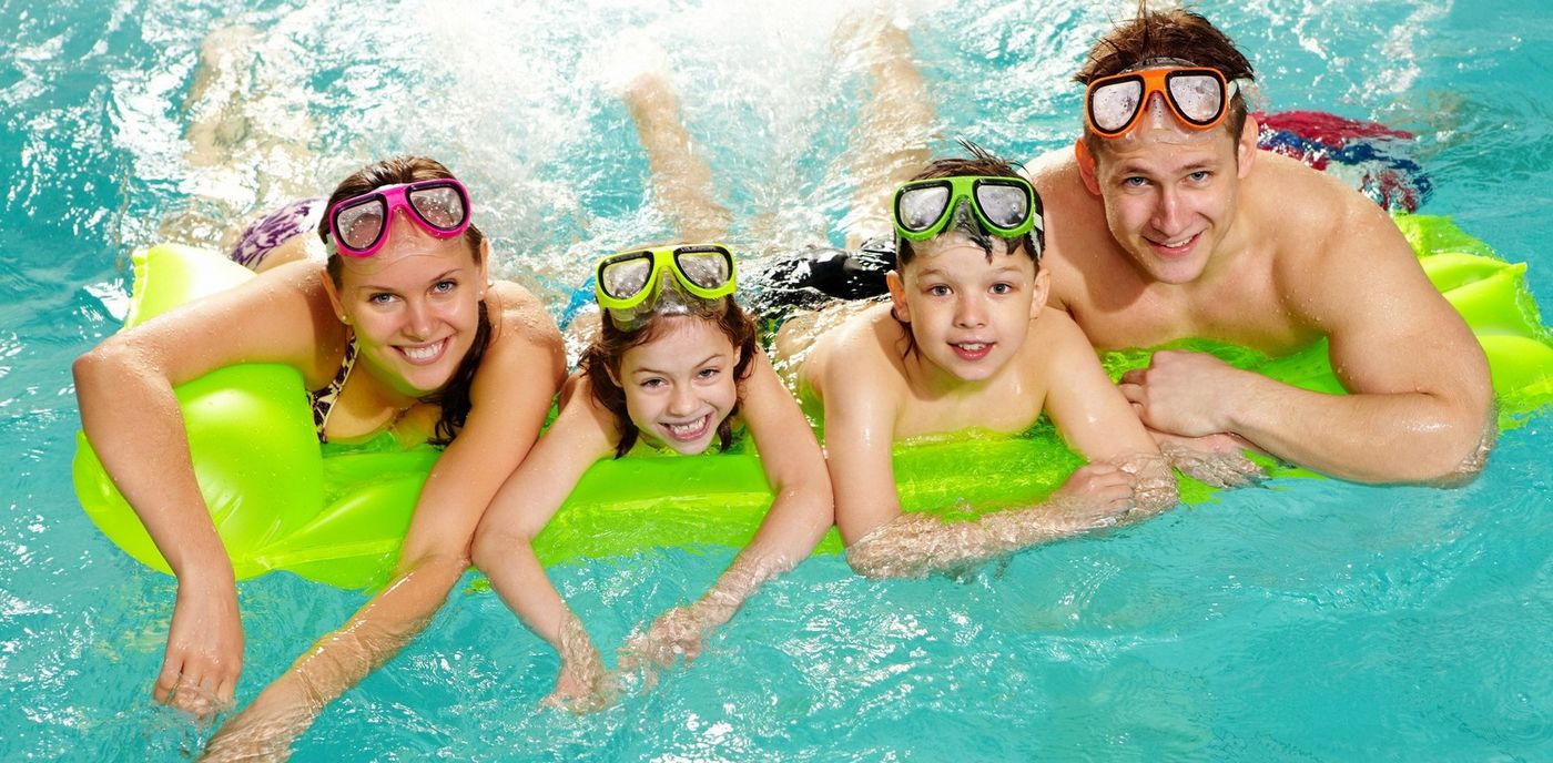 happy-family-swimming-in-pool