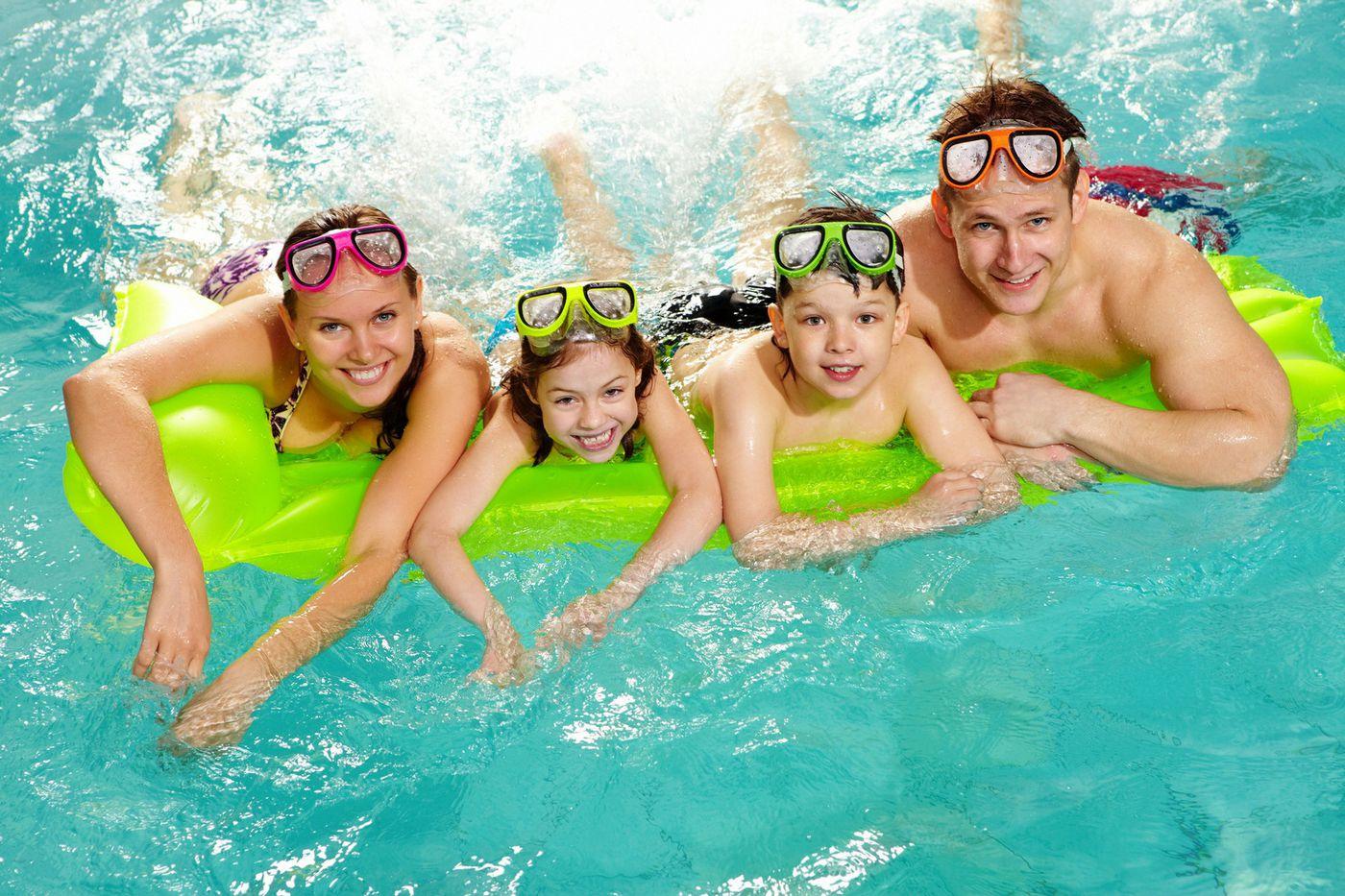 021314424-cheerful-family-swimming-pool-.jpeg