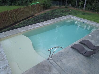 D Series pool in sandstone shimmer with concrete patio