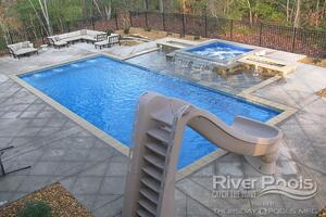 G36 pool with elevated spa, slide, jets, and tanning ledge