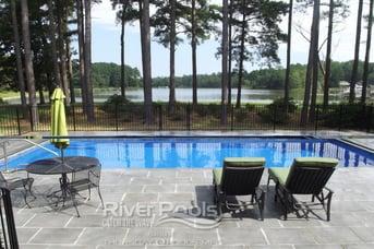 trees around fiberglass pool and patio