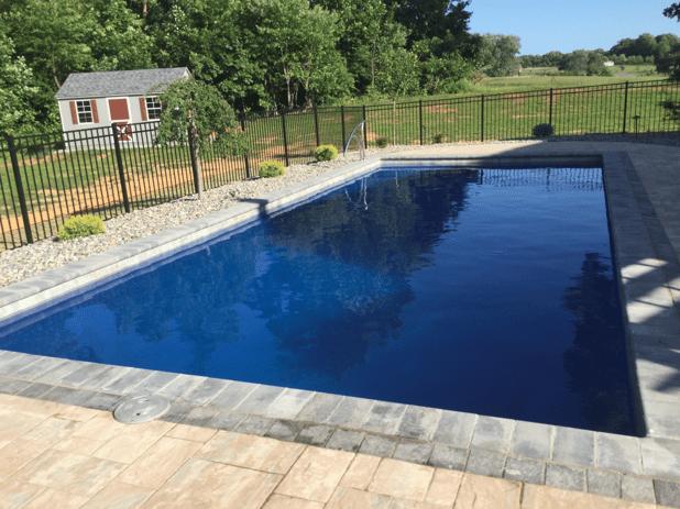 blue fiberglass inground swimming pool
