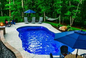 C Series pool with textured concrete patio and in-pool light