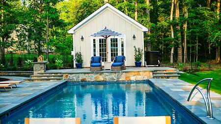 T40 pool in Granite grey with blue and grey waterline tile and natural stone patio