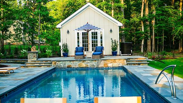 Deep-end pool (T40) with natural stone patio and glass waterline tile