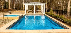 light blue G36 pool with pergola and elevated tanning ledge