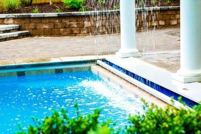stone waterline tile on a G36 fiberglass pool