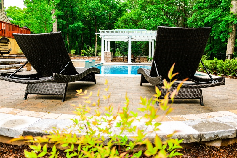 Charming G36 Rectangular Pool With Lawn Chairs And A Pergola