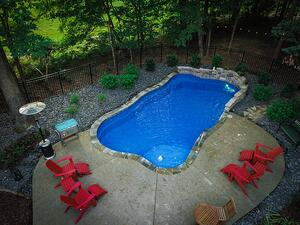 O Series pool with stone wall, cascade, stone coping, and small patio