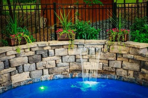 cascade built into a retaining wall for O30 fiberglass pool